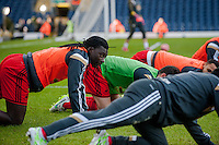 BLACKBURN, ENGLAND - JANUARY 24:   Bafetibis Gomis of Swansea City warms up during the FA Cup Fourth Round match between Blackburn Rovers and Swansea City at Ewood park on January 24, 2015 in Blackburn, England.  (Photo by Athena Pictures/Getty Images)