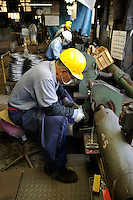 "Finishing process, Oigen ""Nambu Tekki"" ironware foundry, Esashi, Iwate Prefecture, Japan, August 28 2008."