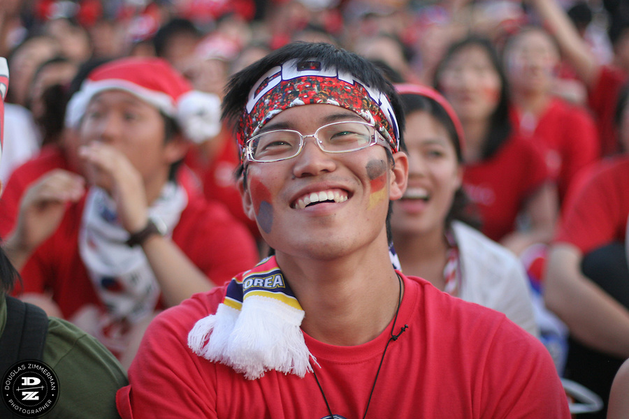 An South Korean National Soccer Team fan smiles while watching Korea's FIFA World Cup first round match against France at the Fan Festival in downtown Leipzig, Germany on Sunday, June 18th, 2006. The teams drew 1-1..