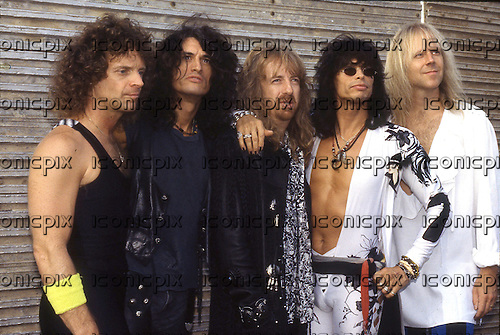 Aerosmith - L-R: Joey Kramer, Joe Perry, Brad Whitford, Steven Tyler, Tom Hamilton - photocall at the Monsters of Rock festival at Castle Donington Leicestershire UK - 18 Aug 1990.  Photo credit: George Bodnar ARchive/IconicPix