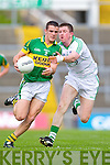 Shane Enright breaks away from John Cooke in the Muster Senior Semi final held in The Gaelic Grounds last Saturday evening.