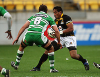 Wellington's Masefau Leuluniu tries to beat Brent Thompson. Air NZ Cup - Wellington Lions v Manawatu Turbos at Westpac Stadium, Wellington, New Zealand. Saturday 3 October 2009. Photo: Dave Lintott / lintottphoto.co.nz