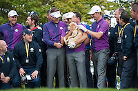 24.09.2014. Gleneagles, Auchterarder, Perthshire, Scotland.  The Ryder Cup.  Ian Poulter, Justin Rose, Sergio Garcia Henrik Stenson (EUR) pose with Jura a 16 week Scottish Police puppy during their practice round.