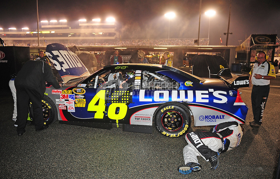 May 2, 2009; Richmond, VA, USA; NASCAR Sprint Cup Series driver Jimmie Johnson sits in the garage for repairs after crashing during the Russ Friedman 400 at the Richmond International Raceway. Mandatory Credit: Mark J. Rebilas-