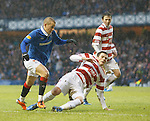 Mikey Devlin then aged 17 makes his debut for Hamilton against Rangers at Ibrox in 2011 as he brings down Vladimir Weiss for a penalty kick during a 4-0 defeat