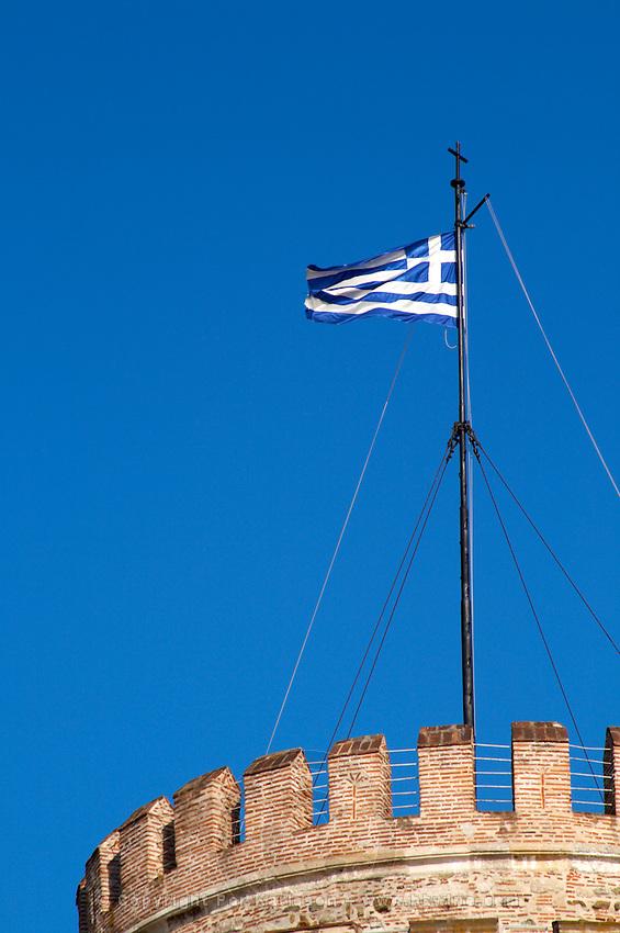 The White Tower. Greek flag. Thessaloniki, Macedonia, Greece