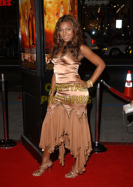 "ASHANTI.Paramount Pictures' L.A. Premiere of ""Coach Carter"" held at The Grauman's Chinese Theatre in Hollywood, California .January 13th, 2005 .full length peach pink silk satin dress flowing hand on hip sequin trim, layered.www.capitalpictures.com.sales@capitalpictures.com.Supplied By Capital PIctures"