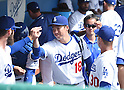 (C-R) Kenta Maeda, Dave Roberts (Dodgers),<br /> MARCH 5, 2016 - MLB :<br /> Kenta Maeda of the Los Angeles Dodgers gets fist bumps from teammates and manager Dave Roberts in the dugout before a spring training baseball game against the Arizona Diamondbacks at Camelback Ranch-Glendale in Phoenix, Arizona, United States. (Photo by AFLO)