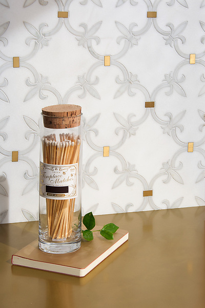 Fleur de Lys, a waterjet stone mosaic, shown in polished Calacatta Gold, Thassos, and Brass, is part of the Jardins Français™ collection by Caroline Beaupere for New Ravenna.<br />
