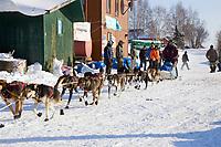 Robert Bundtzens sled dog team leaving Takotna Chkpt during 2006 Iditarod Interior Alaska Winter