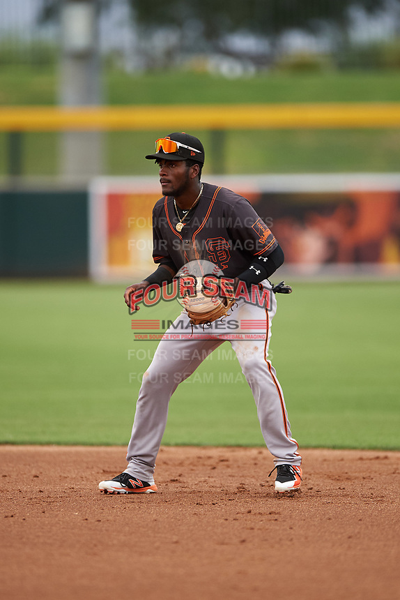 AZL Giants Black second baseman Ghordy Santos (8) during an Arizona League game against the AZL Athletics Gold on July 12, 2019 at Hohokam Stadium in Mesa, Arizona. The AZL Giants Black defeated the AZL Athletics Gold 9-7. (Zachary Lucy/Four Seam Images)