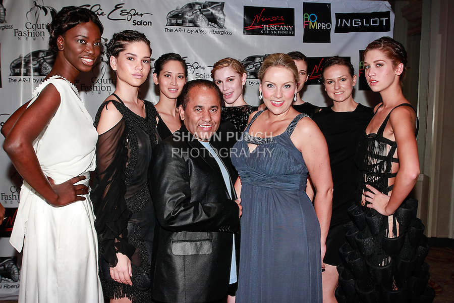 Fashion producer Andres Aquino, poses on red carpet with Soprano singer Christine Reber (front blue dress) and models, during Couture Fashion Week Spring 2012, at the Waldorf Astoria-Hotel in New York City.