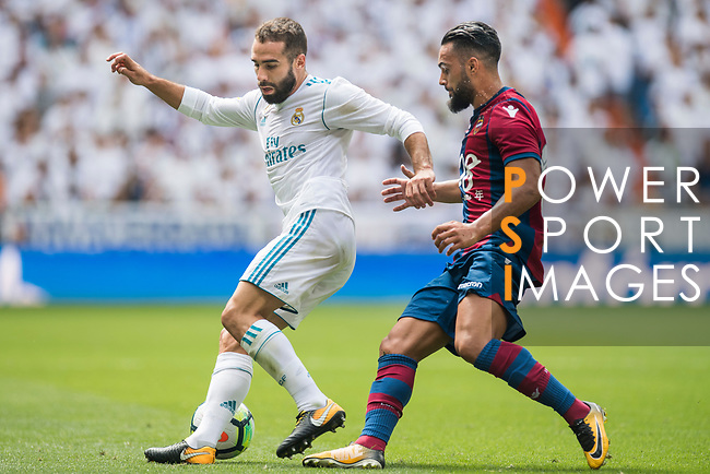 Daniel Carvajal Ramos of Real Madrid (L) fights for the ball with Ivan Lopez Alvarez, Ivi, of Levante UD (R)  during the La Liga match between Real Madrid and Levante UD at the Estadio Santiago Bernabeu on 09 September 2017 in Madrid, Spain. Photo by Diego Gonzalez / Power Sport Images