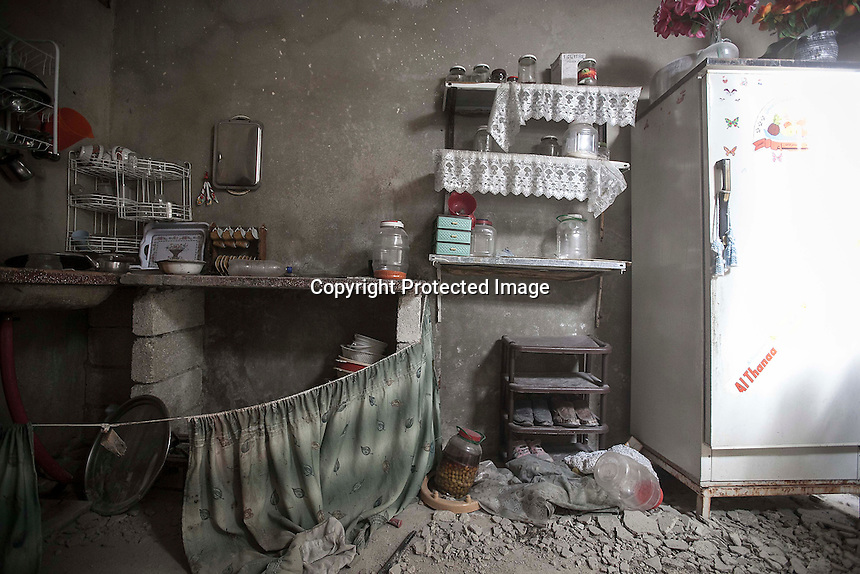 In this Sunday, Dec. 02, 2012 photo, an inside destroyed kitchen is view from a residential house in Amarya neighborhood after the rebel fighters took control of the area over the Syrian army during heavy fighting in Aleppo, the Syrian's largest city. (AP Photo/Narciso Contreras)