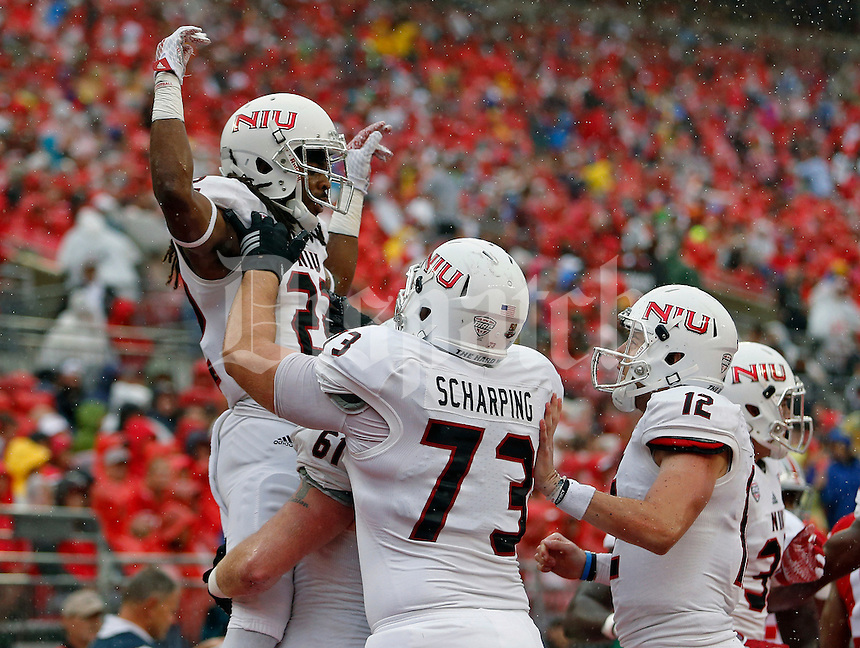 Northern Illinois Huskies wide receiver Aregeros Turner (22) celebrates his touchdown run against Ohio State Buckeyes defense during the 1st quarter of their game at Ohio Stadium on September 19, 2015.  (Dispatch photo by Kyle Robertson)