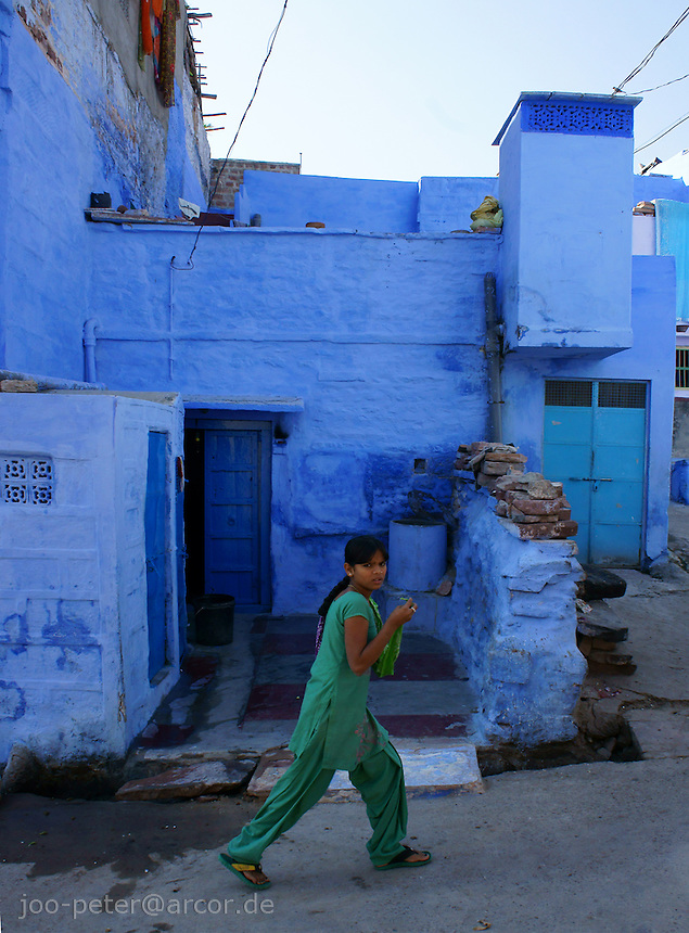 woman in green passing by on streets of Jodphur,, Rajastan, India