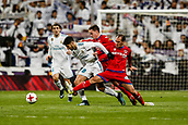 10th January 2018, Santiago Bernabeu, Madrid, Spain; Copa del Rey football, round of 16, 2nd leg, Real Madrid versus Numancia; Marco Asensio (Real Madrid) fights for controls the ball as he shields from 2 defenders