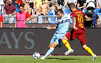 Lazio's Senad Lulic, left, is challenged by Roma's Davide Santon during the Italian Serie A football match between Roma and Lazio at Rome's Olympic stadium, September 29, 2018. Roma won 3-1.<br /> UPDATE IMAGES PRESS/Riccardo De Luca