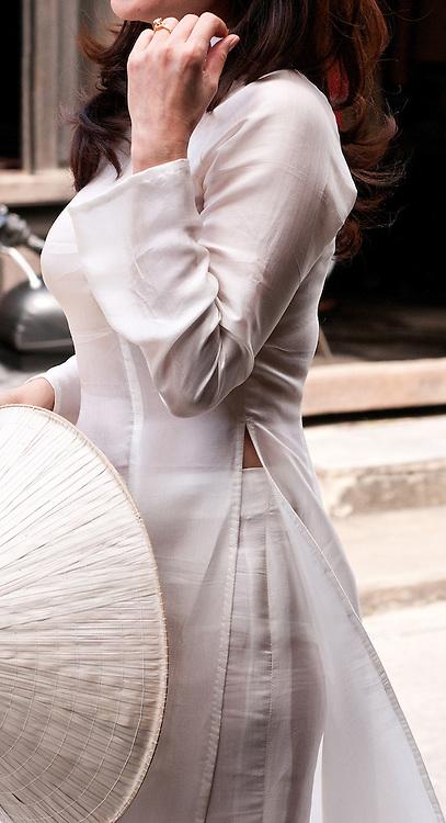 Ao Dai 06 - Vietnamese woman in traditional silk white ao dai, Hoi An, Viet Nam