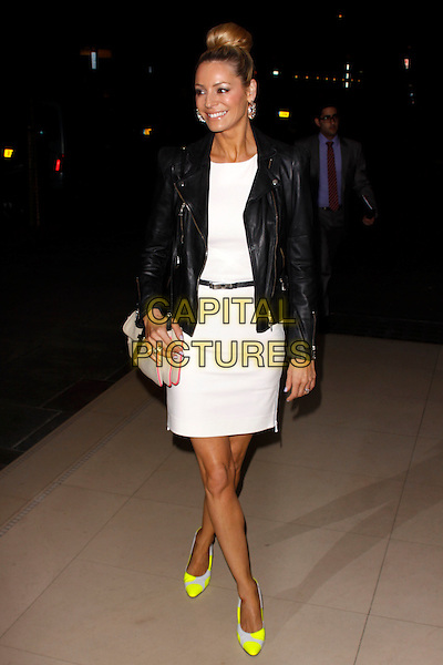 Tess Daly.Rodial Beautiful Awards, Sanderson Hotel, London, England..March 6th, 2012.full length black leather jacket white dress yellow neon fluorescent shoes beige bag purse .CAP/AH.©Adam Houghton/Capital Pictures.