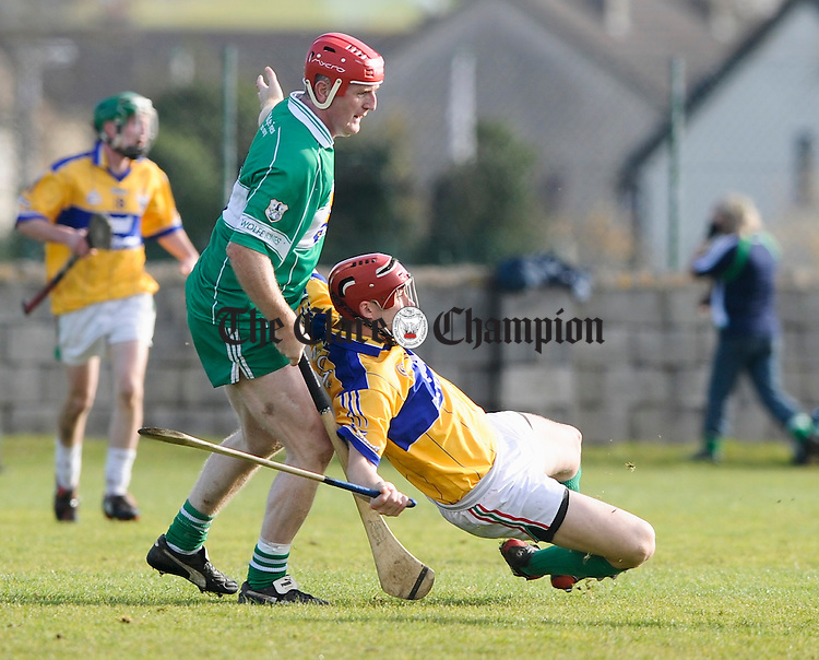 Brian Lohan of Wolfe Tones and Fergal Lynch of Clooney Quin get tangled during their Senior B Final at Clareacastle. Photograph by John Kelly.