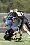 Palos Verdes, CA 10/30/09 - Sam Stekol (MC# 81) is tackled by Aaron Johnson (#81) and another Peninsula player during the Peninsula-Mira Costa football game.