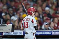 Heston Kjerstad (18) of the Arkansas Razorbacks waits for his turn to bat during the game against the Texas Longhorns in game six of the 2020 Shriners Hospitals for Children College Classic at Minute Maid Park on February 28, 2020 in Houston, Texas. The Longhorns defeated the Razorbacks 8-7. (Brian Westerholt/Four Seam Images)