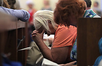 Praying during a Mass Prayer Service Friday at St. Paul's Memorial in Charlottesville, Va. Dr. Cornell West was the featured speaker at the event.  Photo/Andrew Shurtleff