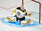 24 September 2009: Boston Bruins' goaltender Tim Thomas makes a glove save without the aid of a stick in the second period against the Montreal Canadiens at the Bell Centre in Montreal, Quebec, Canada. The Bruins defeated the Canadiens 2-1 in an overtime shootout. Mandatory Credit: Ed Wolfstein Photo