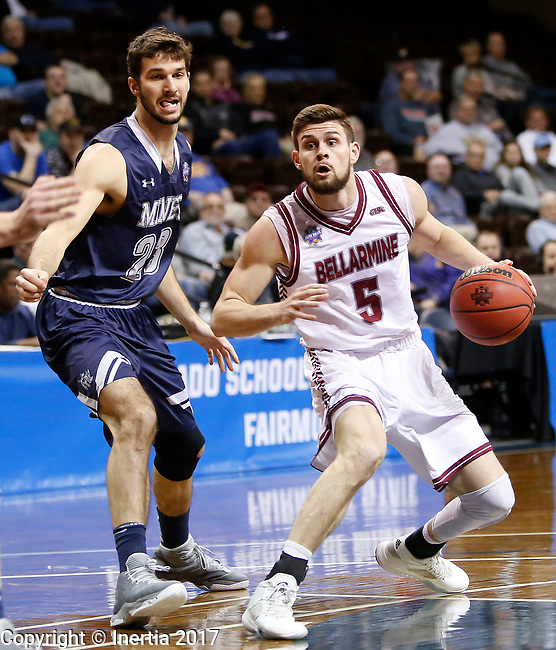 SIOUX FALLS, SD: MARCH 22: Rusty Troutman #5 of Bellarmine drives past Caleb Waitsman #23 of Colorado Mines during the Men's Division II Basketball Championship Tournament on March 22, 2017 at the Sanford Pentagon in Sioux Falls, SD. (Photo by Dick Carlson/Inertia)