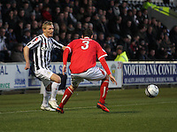 Gary Teale knocks the ball inside Jonathon Brown in the St Mirren v Brechin City William Hill Scottish Cup Round 4 match played at St Mirren Park, Paisley on 1.12.12.