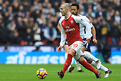 10th February 2018, Wembley Stadium, London England; EPL Premier League football, Tottenham Hotspur versus Arsenal; Jack Wilshere of Arsenal is under pressure from Mousa Dembele of Tottenham Hotspur
