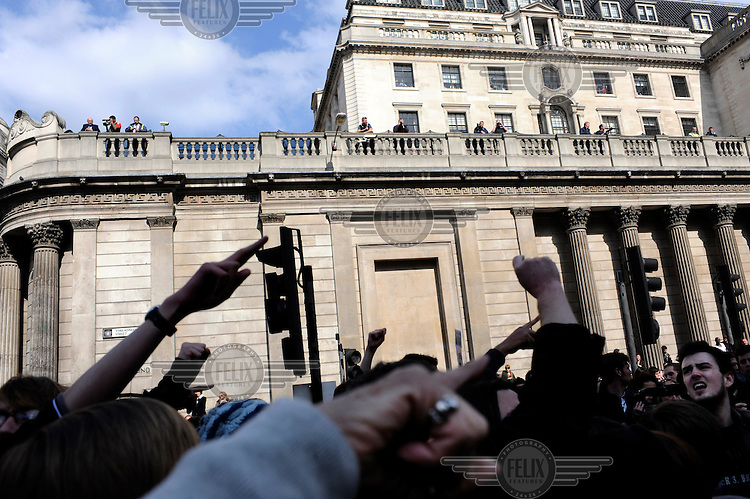 Demonstrators arrive at the Bank of England as thousands of protestors descended on the City of London ahead of the G20 summit of world leaders to express anger at the economic crisis, which many blame on the excesses of capitalism..