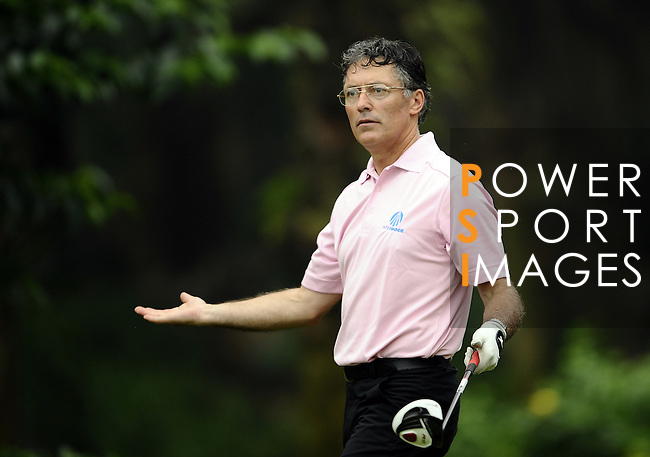 TAIPEI, TAIWAN - NOVEMBER 18: Peter A Smith of Scotland tees off on the 16th hole during day one of the Fubon Senior Open at Miramar Golf & Country Club on November 18, 2011 in Taipei, Taiwan.  Photo by Victor Fraile / The Power of Sport Images