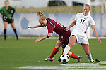 05 November 2008: Florida State's Ellie Stephan (17) plays the ball away from Virginia Tech's Emily Jukich (left). Virginia Tech and Florida State University played to a 0-0 tie after two overtimes at Koka Booth Stadium at WakeMed Soccer Park in Cary, NC in a women's ACC tournament quarterfinal game.  Virginia Tech advanced to the semifinal round in penalty kicks, 4-2.