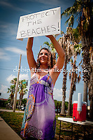 Jenny Stiny, Seminole, Florida holds a sign and waves at honking supporters at the BP service station in St. Petersburg, Florida during the 'Worldwide BP Boycott' on Saturday, June 12, 2010. Volunteers from the Suncoast Seabird Sanctuary were on-hand to raise donations, Emergency Call List volunteers, and items & materials needed to prepare for injured birds and coastal cleanup,  Photo by Debi PIttman Wilkey