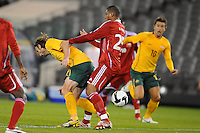 MELBOURNE, AUSTRALIA - OCTOBER 14: Joshua Kennedy from Australia is pushed by Khalifa Naufli from Oman in a AFC Asian Cup 2011 match between Australia and Oman at Etihad Stadium on October 14, 2009 in Melbourne, Australia. Photo Sydney Low www.syd-low.com