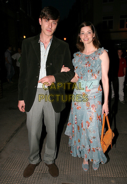 SIENNA GUILLORY & ENZO.New Ambassador's Theatre - 'The Shape Of Things Press Night.full length, full-length blue floral print dress, frills, ribbon, summery, orange leather, suede purse, bag.www.capitalpictures.com.sales@capitalpictures.com.© Capital Pictures.