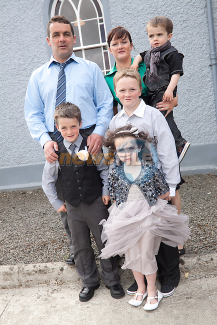 T. J. Doheny at First Communion in Phillipstown Church on Sunday, pictured with his family Bob, Sandra, Evan, Katie and Connor. Picture: Newsfile/Mark Carroll.