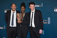 "French film producers Christophe Barral (R) and Toufik Ayadi (L) pose with French film director Alice Diop (C) during a photocall after winning the Best Short Film award for ""Vers la tendresse"" (To the tenderness) during the 42nd edition of the Cesar Ceremony at the Salle Pleyel in Paris on February 24, 2017."