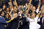 20 November 2011: Galaxy owner Philip F. Anschutz (left) and captain Landon Donovan (10) hold the Philip F. Anschutz Trophy overhead. The Los Angeles Galaxy defeated the Houston Dynamo 1-0 at the Home Depot Center in Carson, CA in MLS Cup 2011, Major League Soccer's championship game.