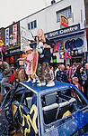 Camden Hight street is shut down by Reclaim the Streets (RTS).  `RTS  was born of the road protests at Twyford Down and the M11 , a response to the prevailing  car culture and assocaited pollution and  alienation.