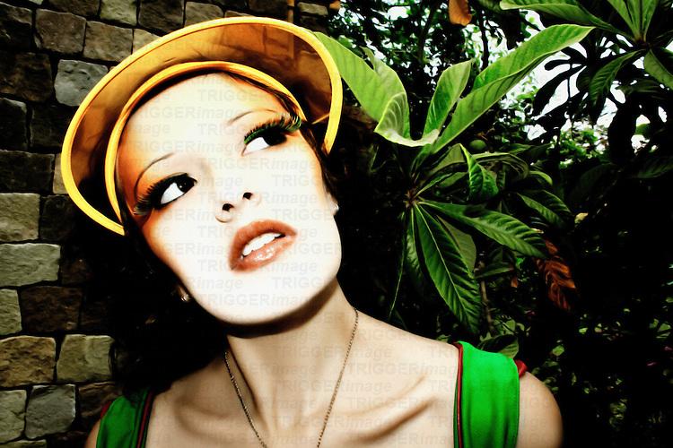 A young woman wearing a sun visor in the garden