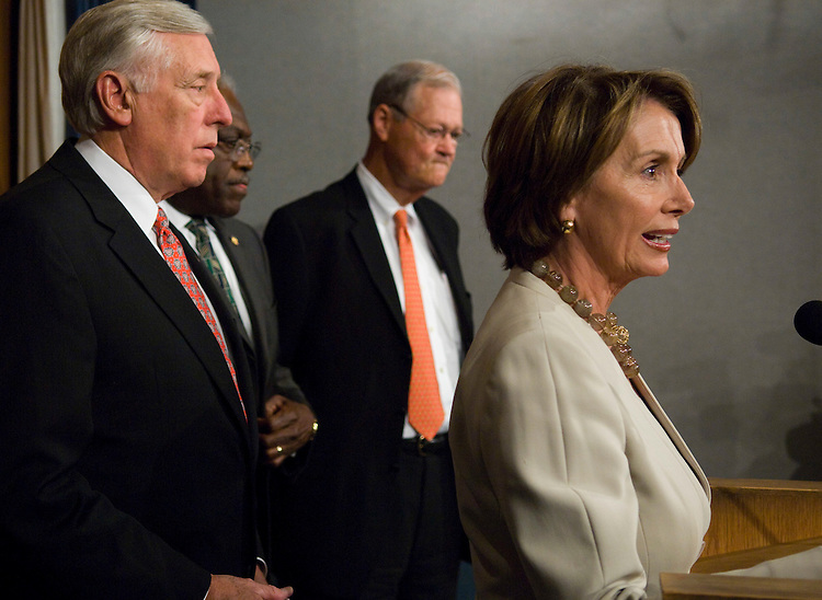 "WASHINGTON - July 12: House Majority Leader Steny Hoyer, D-Md., House Majority Whip James E. Clyburn, D-S.C., House Armed Services Chairman Ike Skelton, D-Mo., and House Speaker Nancy Pelosi, D-Calif., during a news conference after the House voted Thursday to set an April 1, 2008, deadline for a withdrawal of most U.S. troops from Iraq, even as President Bush insisted that more time is needed to stabilize the ""young democracy"" there. After a day-long debate, the House by 223-201 passed a bill (HR 2956) that would force a change of course in Iraq. The measure would require a troop redeployment to begin within 120 days of enactment and be completed by April 1, 2008. The vote marked the second time this year that the Democratic-controlled House has voted to set a firm deadline for a troop withdrawal. In March, the House by 218-212 passed a fiscal 2007 Iraq war supplemental funding bill (HR 1591) that set an August 2008 target. Bush vetoed a modified version of that legislation, and he has vowed to veto any bill that similarly attempts to force his hand on Iraq. House Democrats argued that an interim progress report on this year's U.S. troop surge issued Thursday morning simply confirmed that it was time to start withdrawing most U.S. troops and redefining the mission of those who remained. Republicans countered that a U.S. withdrawal would ensure the collapse of the Iraqi government and potentially destabilize the entire region. They said it was important to give the troop surge more time. (Photo by Scott J. Ferrell/Congressional Quarterly)."