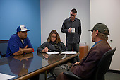Los Angeles, California<br /> January 31, 2014<br /> <br /> Matthew Rayburn (standing), the Regional Manager for PATH's Central LA VASH offices and two PATH case workers interview 55 yr old homeless Navy veteran David Hauser to see if he is eligible for a HUD Vash housing voucher. <br /> <br /> David has been homeless for three years.