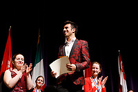 Stage IV finalist Valerio Lisci from Italy receives the Rachel Mary and John Isaac Jones Memorial Prize (second prize) during the awards ceremony of the 11th USA International Harp Competition at Indiana University in Bloomington, Indiana on Saturday, July 13, 2019. (Photo by James Brosher)