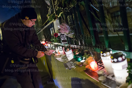 Man lights a candle in support for the terrorist attack victim staff of the Charlie Hebdo satirical weekly in front of the French Embassy in Budapest, Hungary on January 08, 2015. ATTILA VOLGYI