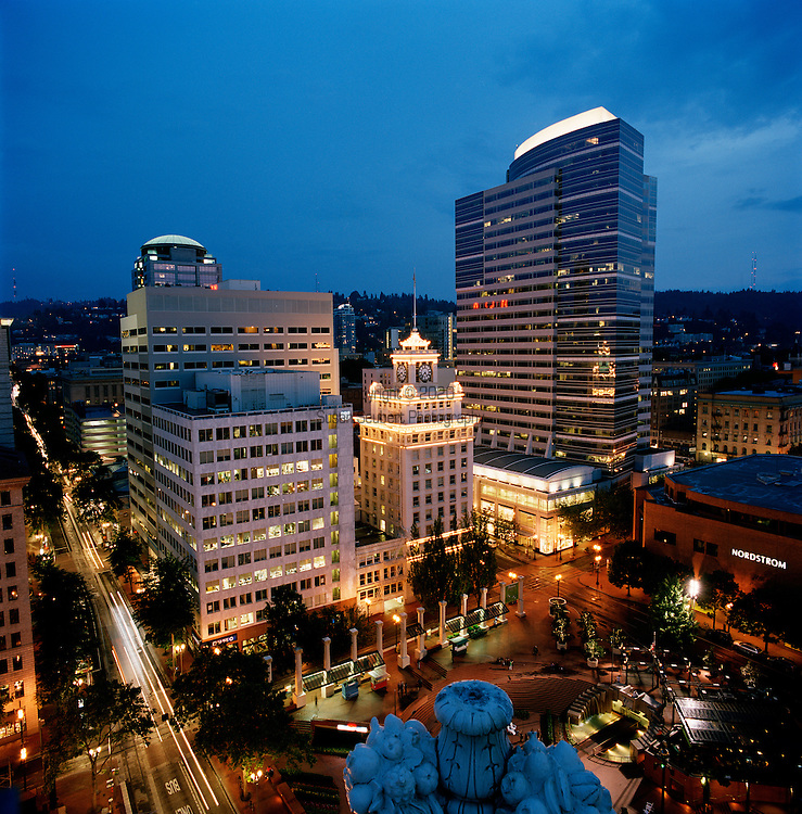 The evening view of downtown Portland's Pioneer Courthouse square from the outdoor lounge of the Departure's restaurant in the Nine's Hotel.