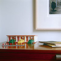 A model garage is displayed on one of the 1950's sideboards in the dining room