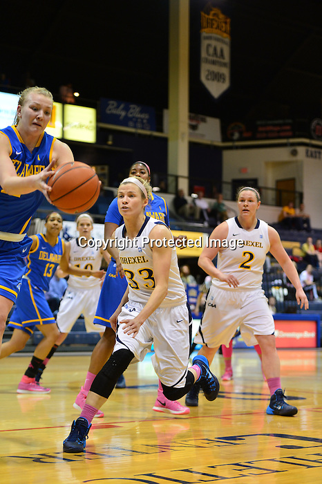 PHILADELPHIA - The Drexel women's basketball team came up just short in its attempt to earn a season sweep of Delaware on Tuesday evening, as the Dragons hit just one field goal in the last 3:30 of play and fell, 55-50. Drexel led by as many as 10 early on, but shot just 30.4 percent from the floor on the night as the Dragons missed an opportunity to regain control of second place in the Colonial Athletic Association.<br /> <br /> Tory Thierolf scored a career-high 16 points for the Dragons (12-13, 7-5), including 12 points in the second half. The senior was 4-of-5 from long range and nailed two big three-pointers to keep Drexel close in the closing minutes. Meghan Creighton added 12 points, all on three-pointers, as the sophomore became just the ninth player in Drexel history to reach 100 career three-pointers. She now sits at 103 for her career.<br /> <br /> Courtni Green led the Blue Hens (17-6, 9-3) with 18 points. Drexel did an admirable job shutting down Delaware's leading scorer, Kelsey Buchanan, who finished with eight points and seven rebounds despite being saddled with foul trouble for much of the night. Nevertheless, Green and Erika Brown, who had seven points and eight assists, stepped up in her stead.<br /> <br /> Drexel jumped out to a big lead early, holding Delaware to just one field goal - a Green three-pointer - in the game's first 8:05. The Dragons did not come out firing on all cylanders, but still took a 12-3 lead when Abby Redick converted an old-fashioned three-point play with 12:13 remaining in the first half. Less than two minutes later, the Dragons hit their largest lead when Carrie Alexander's short jumper put them ahead 17-7.<br /> <br /> The Blue Hens responded with nine straight points over the next 2:52, slashing Drexel's lead down to a single point. Although Delaware remained close, the Dragons kept the lead to themselves until Alecia Bell knocked down two free throws with 2:43 remaining in the first half.